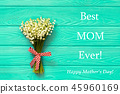 Happy Mother's day text on blue rustic wooden background. greeting card concept spring flowers flat 45960169