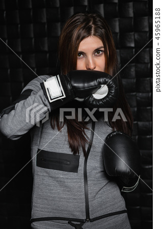 Portrait of a charming sporty brunette 45965188