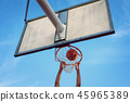 Street basketball athlete performing slam dunk  45965389