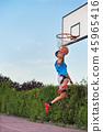 Basketball street player making a slam dunk 45965416