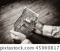Young woman hands holding little cart 45969817