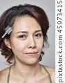 Closeup beautiful woman with eyebrow brush tool on gray 45973415