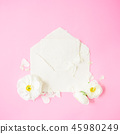 Composition with white flowers, petals and envelop 45980249