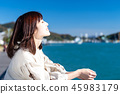 Woman relaxing at the seaside 45983179