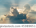 sunset with towering cumulus clouds 45989651