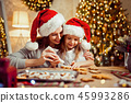 Merry Christmas and Happy Holidays. Mother and daughter cooking Christmas cookies. 45993286