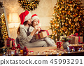 a happy family mother and child pack Christmas gifts 45993291