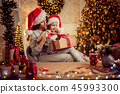 a happy family mother and child pack Christmas gifts 45993300