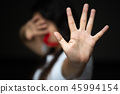 Woman hand sign for stop and wrapping her mount 45994154