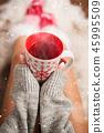 Girl in Christmas socks enjoying a winter time. 45995509