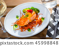 Salmon steak on carrot brush 45998848