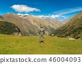 Hiker man walking mountains 46004093