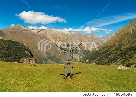 Hiker man walking mountains 46004095