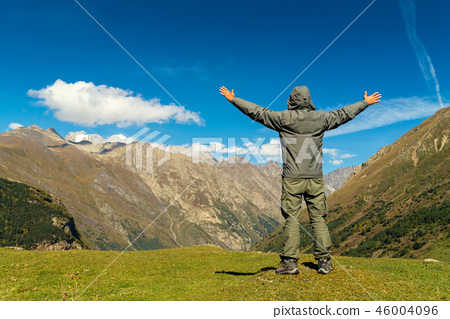 Hiker man walking mountains 46004096