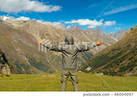 Hiker man walking mountains 46004097