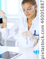 Female scientific researcher or blood test assistant at work in laboratory. Science, medicine and 46005887