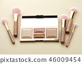 Make up palette and brushes on beige background 46009454