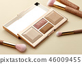 Make up palette and brushes on beige background 46009455