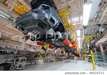 transfer of car body bottom view. Robotic equipment makes the Assembly of car. Modern car Assembly 46016721