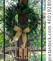 Green christmas wreath with pine cones hanging 46019280