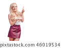 Happy young woman standing isolated over white wall background. Looking camera showing copyspace 46019534