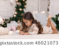 Cute child girl writing letter to Santa Claus at home 46021073
