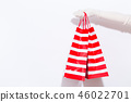 Woman holding shopping bags 46022701