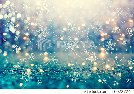 Snowflakes on an abstract shiny light background 46022724