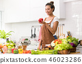 Asian woman in a kitchen preparing healthy meal 46023286