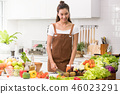 Asian woman in a kitchen preparing healthy meal 46023291