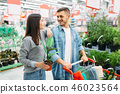 Couple with cart buying home flower in supermarket 46023564
