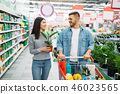 Couple with cart buying home flower in supermarket 46023565
