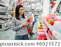 Couple choosing candles in supermarket, shopping 46023572