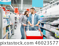 Couple with cart in a supermarket, family shopping 46023577