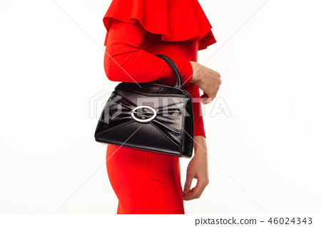 Beautiful woman with a black handbag  46024343