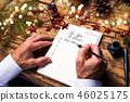 Senior writing new year resolutions 46025175