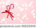 Christmas candy canes on pink background. 46026946