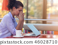 Stressed hipster businesswoman working on laptop in her office 46028710