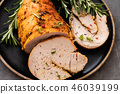 Stuffed turkey breast with baked vegetables and spices on a black background. 46039199