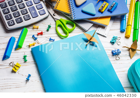 On a white table is a notebook. Back to school background 46042330