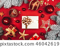 Many presents among sparkling Christmas decorations on red background. 46042619