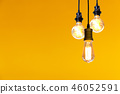 Vintage light bulb hanging over  46052591