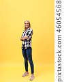 Full length laughing model in studio. looking at camera. isolated yellow background 46054568