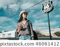 happy teenage girl standing over route 66 46061412