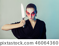 woman with knife 46064360