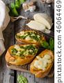 Garlic herbs toast with fresh mozzarella 46064469