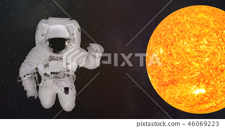 Astronaut in outer space near the Sun 46069223