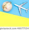 Toy plane traveling world globe concept on blue 46077554