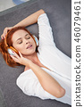 Portrait of beautiful woman in morning listening music sitting o 46079461