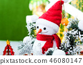 The snowman with red wool hat with christmas tree. 46080147